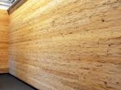 Wandverkleidung aus gehacktem Holz (Häusermann)